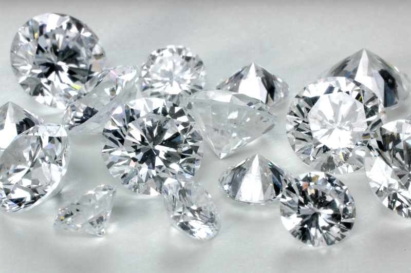 Round brilliant polished diamonds.